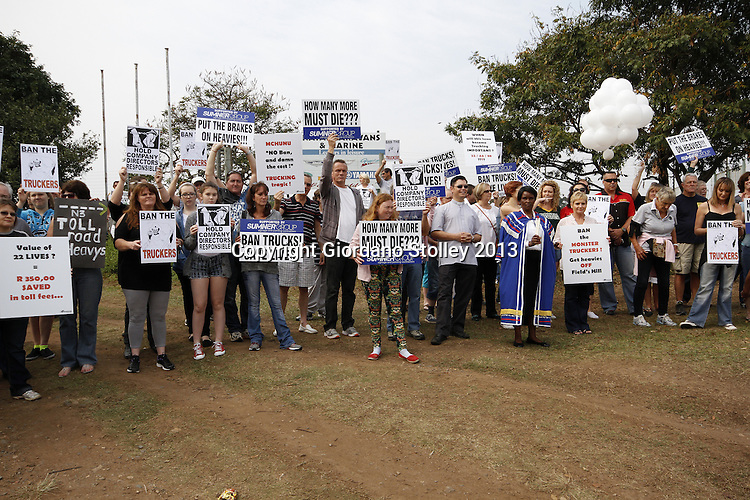 DURBAN - 14 September 2013 - Hundreds staged a protest to ban heavy duty vehicles from Fields Hill. They protest at the same scene where a week earlier a lorry's brakes failed and it ploughed through four taxis and two cars killing 23 people. Picture: Allied Picture Press/APP