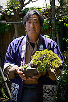 Kouichi Sato, staff at Tojuen bonsai nursery. Bonsai festival, Bonsai-mura, Omiya, Saitama Prefecture, Japan, May 3, 2013. The Omiya Bonsai Village was founded in 1925 and is Japan's most famous production center for bonsai.