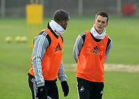 FAO SPORTS PICTURE DESK<br /> Pictured L-R: Luke Moore and Chelsea loan Josh McEachran. Tuesday 17 January 2012<br /> Re: Premier League side Swansea City Football Club training in Llandarcy, south Wales.