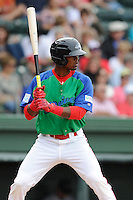 Center fielder Joseph Monge (15) of the Greenville Drive bats in a game against the Augusta GreenJackets on Sunday, April 12, 2015, at Fluor Field at the West End in Greenville, South Carolina. Augusta won, 2-1. (Tom Priddy/Four Seam Images)