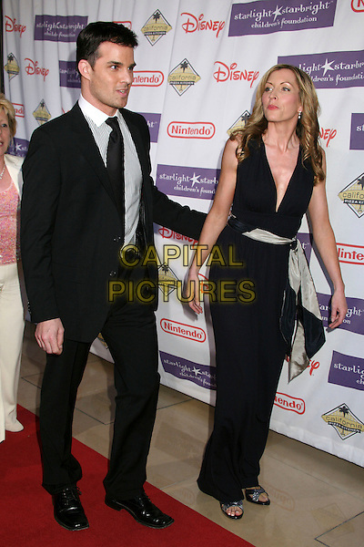 "JONATHAN ROBERTS & HEATEHR MILLS.Starlight Starbright Foundation's ""A Stellar Night Gala"" 2007 at the Beverly Hilton Hotel, Beverly Hills, California , USA, 23 March 2007..full length black dress scarf belt.CAP/ADM/BP.©Byron Purvis/AdMedia/Capital Pictures."