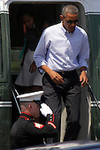 United States President Barack Obama, right, and daughter Malia Obama, 16, walk out of Marine One after arriving at the Martha's Vineyard Airport in West Tisbury, Massachusetts, U.S., on Saturday, August  9, 2014.  The Obama's are vacationing on the island for two weeks.<br /> Credit: Matthew Healey / Pool via CNP
