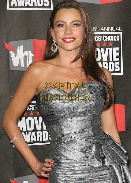 SOFIA VERGARA .at The16th Annual Critics' Choice Movie Awards held at The Hollywood Palladium in Hollywood, California, USA, January 14th, 2011..half length strapless grey gray silver dress peplum ruffle hand on hip .CAP/RKE/DVS.©DVS/RockinExposures/Capital Pictures.