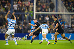 September 29, 2018. Jose Amalfitani, Buenos Aires, Argentina. Ryan Crotty kicks the ball over Jeronimo De La Fuente defense.