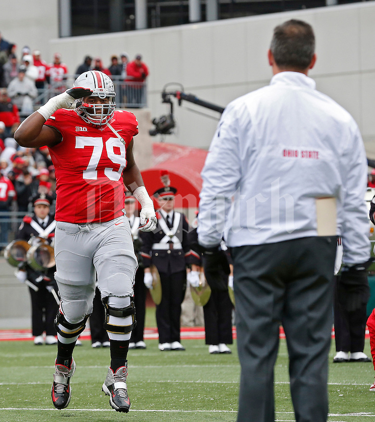 Ohio State Buckeyes offensive linesman Marcus Hall (79) salutes head coach Urban Meyer during a Senior Day Celebration prior to the start of the game against Indiana at Ohio Stadium in Columbus, Ohio on November 23, 2013.  (Chris Russell/Dispatch Photo)