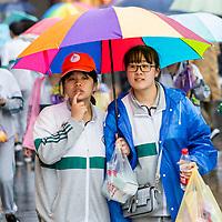 Nanjing, Jiangsu, China.  Young Chinese Women Shopping in the Rain.