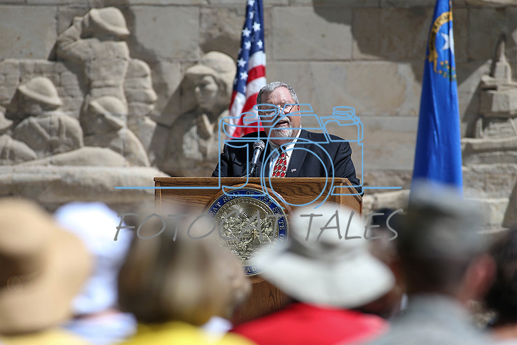 Emcee Guy Clifton speaks at the Nevada National Guard's 18th annual Flag Day ceremony at the Capitol in Carson City, Nev., on Tuesday, June 14, 2016.<br />Photo by Cathleen Allison