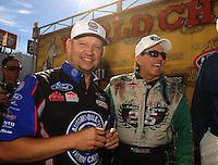 Nov 14, 2010; Pomona, CA, USA; NHRA funny car drivers Robert Hight (left) and John Force during the Auto Club Finals at Auto Club Raceway at Pomona. Mandatory Credit: Mark J. Rebilas-