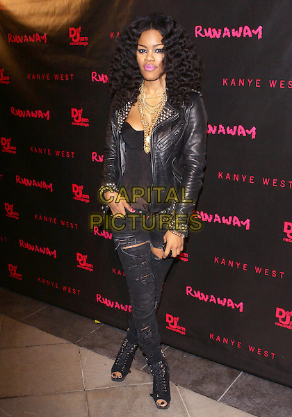 """TEYANA TAYLOR.Los Angeles Premiere of """"Runaway"""" held at Harmony Gold Preview House, Los Angeles, California, USA..October 18th, 2010.full length black jeans denim ripped torn leather jacket lace top open toe boots shoes hand in pocket gold necklaces .CAP/ADM/TC.©T. Conrad/AdMedia/Capital Pictures."""