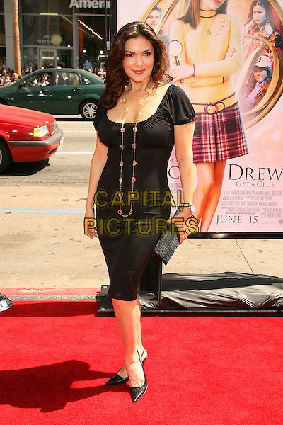 "LAURA HARRING.""Nancy Drew"" World Premiere held at Grauman's Chinese Theatre, Hollywood, California, USA, 09 June 2007..full length black dress buttons.CAP/ADM/RE.©Russ Elliot/AdMedia/Capital Pictures."