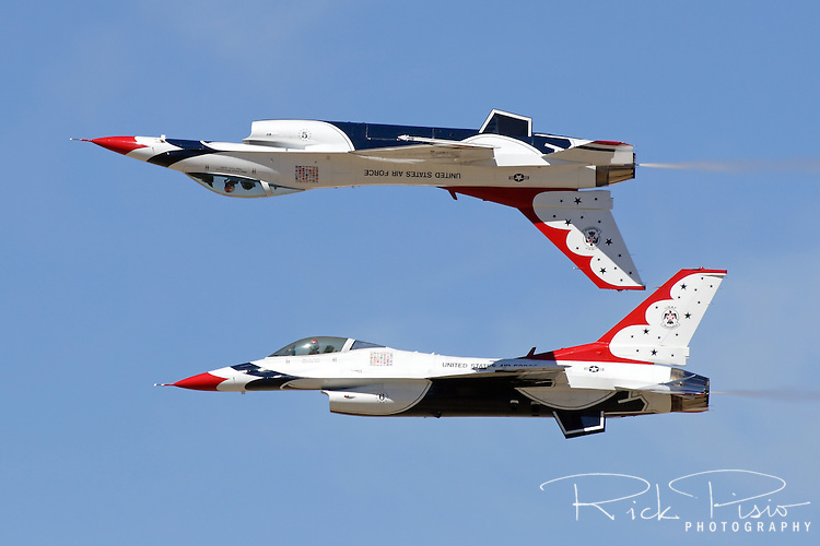The United States Air Force Thunderbirds Lead and Opposing Solo aircraft (#5 and #6) perform the Calypso Pass during a flight demonstration at the 2006 Reno National Championship Air Races at Stead Field in Nevada. The Thunderbirds were formed in 1956 and have been flying the F-16C Fighting Falcon since 1992. Photographed 09/06