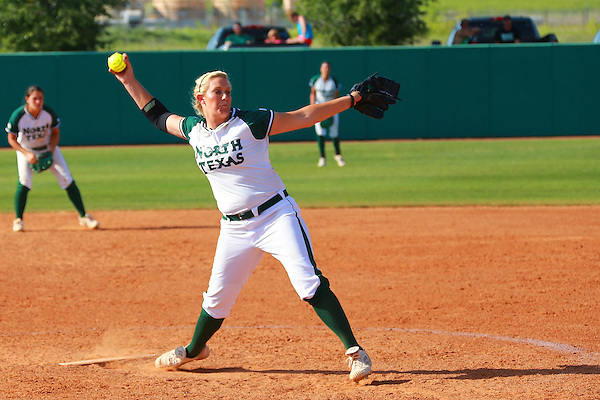Denton, TX -APRIL 27: Ashley Kirk #22 of University of North Texas mean green softball throws against the University of Louisiana Monroe at Lovelace Field in Denton on April 27, 2012 in Denton, Texas. (Photo by Rick Yeatts)