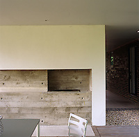 A concrete barbeque in the sheltered outdoor dining area