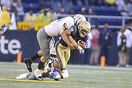 Annapolis, MD - September 8, 2018: Navy Midshipmen quarterback Malcolm Perry (10) gets tackled by several Memphis Tigers defenders during the game between Memphis and Navy at  Navy-Marine Corps Memorial Stadium in Annapolis, MD.   (Photo by Elliott Brown/Media Images International)