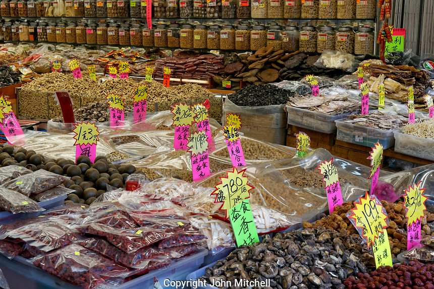 Bins and jars of traditional Chinese dried food and herbs in a shop in Chinatown, Vancouver, British Columbia, Canada
