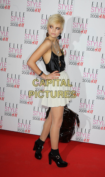 PIXIE GELDOF.Red Carpet arrivals at the Elle Style Awards, held at the Westway, London, England. .February 12th, 2008.full length black satin vest camisole top cream skirt ankle boots hand on hip earrings bag pleats pleated .CAP/ROS.©Steve Ross/Capital Pictures.