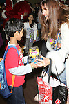 Supermodel Carol Alt Distributes Toys At The POLICE ATHLETIC LEAGUE AND CITYSIGHTS NY TEAM UP FOR ANNUAL HOLIDAY PARTY AND TOY DRIVE At The Police Athletic League, Harlem NY  12/15/12