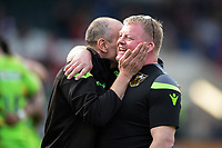 Northampton Saints Head Coach Alan Dickens and Assistant Coach Dorian West celebrate at the final whistle. Aviva Premiership match, between Leicester Tigers and Northampton Saints on April 14, 2018 at Welford Road in Leicester, England. Photo by: Patrick Khachfe / JMP