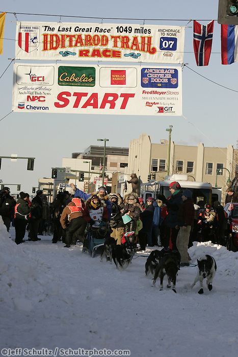 March 3, 2007   In honor of the late 4-time Iditarod champion, Susan Butcher, her husband David Monson and their daughters Tekla and Chisana take a team down 4th avenue during the Iditarod ceremonial start day in Anchorage