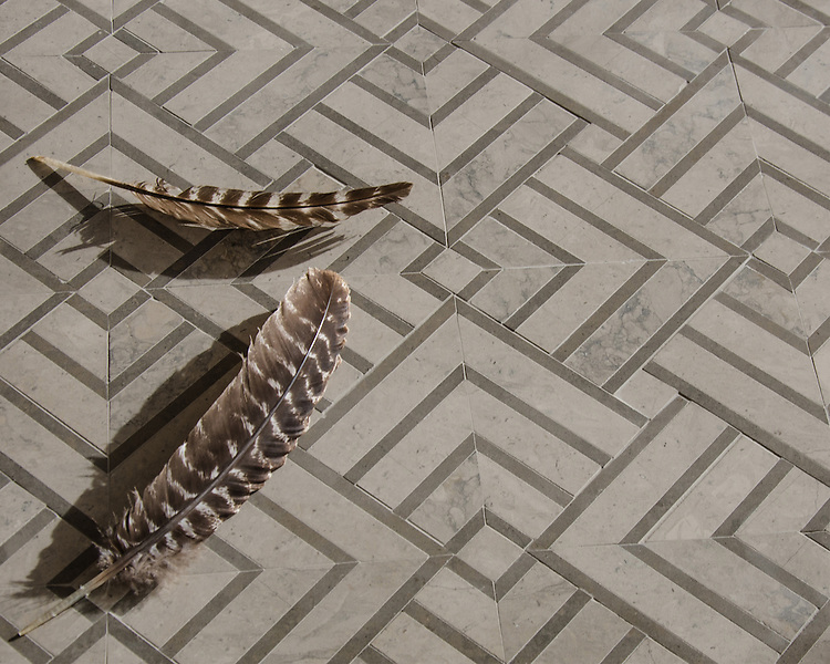 Delaunay, a hand-cut stone mosaic, shown in honed Palomar and Montevideo, is part of the Palazzo™ collection by New Ravenna.