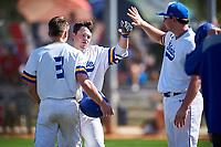 South Dakota State Jackrabbits Braeden Brown (32) celebrates with teammates after hitting a home run during a game against the FIU Panthers on February 23, 2019 at North Charlotte Regional Park in Port Charlotte, Florida.  South Dakota State defeated FIU 4-3.  (Mike Janes/Four Seam Images)