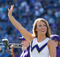 A cheerleader flashes the W.