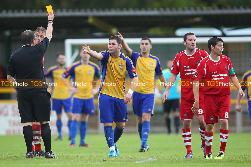 Tom Richardson (C) of Romford is shown a yellow card - Romford vs Needham Market - Ryman League Division One North Football at Ship Lane, Thurrock FC - 04/10/14 - MANDATORY CREDIT: Gavin Ellis/TGSPHOTO - Self billing applies where appropriate - contact@tgsphoto.co.uk - NO UNPAID USE