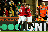 27th Ocotber 2019; Carrow Road, Norwich, Norfolk, England, English Premier League Football, Norwich versus Manchester United; Marcus Rashford of Manchester Utd celebrates with team mates as he scores for 0-2 in the 30th minute - Strictly Editorial Use Only. No use with unauthorized audio, video, data, fixture lists, club/league logos or 'live' services. Online in-match use limited to 120 images, no video emulation. No use in betting, games or single club/league/player publications