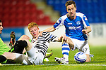 St Johnstone v Queens Park....25.09.12      Scottish Communities League Cup 3rd Round.Steven MacLean is blocked by Peter Bradley.Picture by Graeme Hart..Copyright Perthshire Picture Agency.Tel: 01738 623350  Mobile: 07990 594431