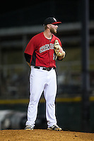 Hickory Crawdads relief pitcher John Fasola (23) looks to his catcher for the sign against the Savannah Sand Gnats at L.P. Frans Stadium on June 15, 2015 in Hickory, North Carolina.  The Crawdads defeated the Sand Gnats 4-1.  (Brian Westerholt/Four Seam Images)