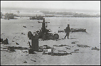 BNPS.co.uk (01202 558833)<br /> Pic: BNPS<br /> <br /> A soldier walking past the axle and wheels of a large military vehicle destroyed by the German guns.<br /> <br /> Haunting photos which capture the trail of devastation left in the wake of the Dunkirk evacuation have been unearthed after 77 years.<br /> <br /> The poignant pictures were taken soon after 330,000 Allied troops had been rescued from the beaches by an armada of little ships having been defeated by the Germans.<br /> <br /> The epic operation is about to be the subject of the new Hollywood blockbuster movie 'Dunkirk' will stars Tom Hardy and Harry Styles and is die for release on July 21.<br /> <br /> The black and white snaps show German soldiers surveying the wreckage which included destroyed ships and large military trucks lying in the surf.<br /> <br /> They are being sold by Duke's Auctioneers.
