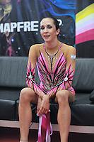 "Neta Rivkin of Israel smiles from ""kiss & cry"" during event finals  at 2010 Grand Prix Marbella at San Pedro Alcantara, Spain on May 16, 2010. Neta placed 14th AA at Marbella 2010. (Photo by Tom Theobald)."