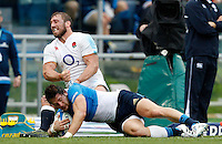 Rugby, Torneo delle Sei Nazioni: Italia vs Inghilterra. Roma, 14 febbraio 2016.<br /> Italy&rsquo;s Michele Campagnaro, right, is tackled by England&rsquo;s Chris Robshaw during the Six Nations rugby union international match between Italy and England at Rome's Olympic stadium, 14 February 2016.<br /> UPDATE IMAGES PRESS/Riccardo De Luca