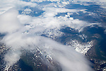 Broken cumulus cloud seen from above looking down over mountains, western Norway