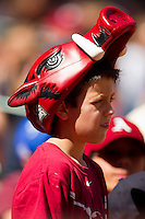 A young Arkansas Razorbacks fan cheers on his team as they played the Texas Longhorns at Minute Maid Park on March 4, 2012 in Houston, Texas.  The Razorbacks defeated the Longhorns 7-3.  Brian Westerholt / Four Seam Images
