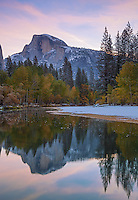 Yosemite National Park, CA<br /> Half Dome (8842 ft) reflected in the Merced River at dawn after a snowfall in late falll in Yosemite Valley