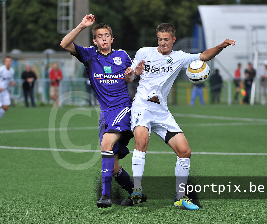 20130831 - BRUGGE , BELGIUM : Brugge's Diego Seron (r) pictured with Anderlecht's Youri Lapage (l) during the Under 19 ELITE soccer match between Club Brugge U19 and RSC Anderlecht U19 , of the second matchday in the -19 Elite competition. Saturday 31 August 2013. PHOTO DAVID CATRY