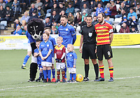 Club captains Stephen Dobbie (left) and Stuart Bannigan with match Referee Andrew Dallas before the SPFL Ladbrokes Championship football match between Queen of the South and Partick Thistle at Palmerston Park, Dumfries on  4.5.19.