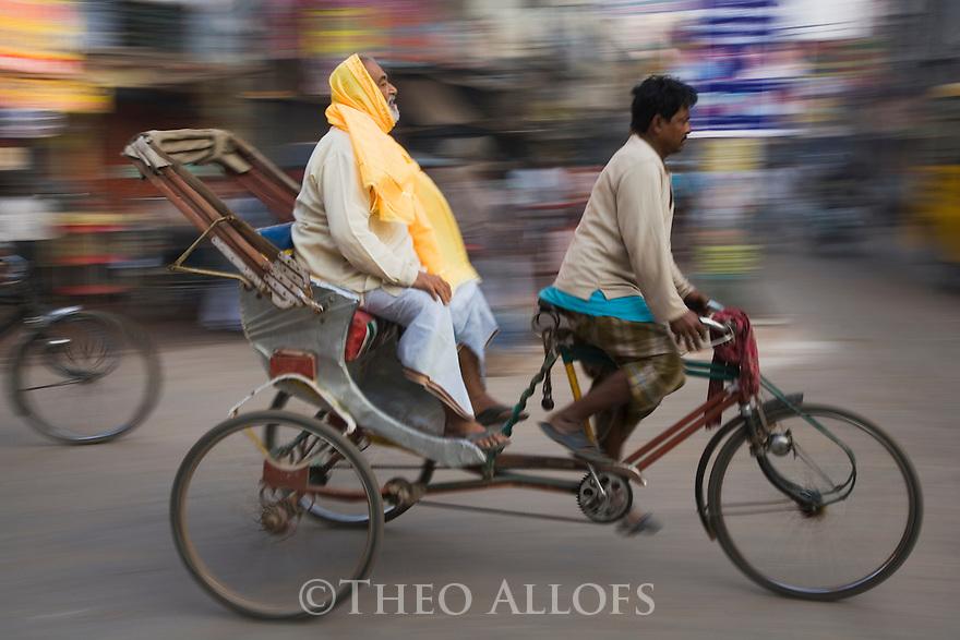 Motion Blur of man riding on a local rickshaw at India's Pushkar Camel Fair, Pushkar, Rajasthan, India