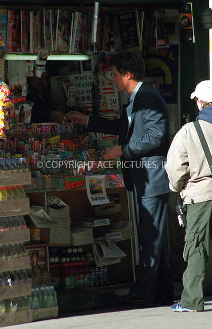 British actor HUGH GRANT buys some candies while on a break from filming his new untitled movie in Downtown, New York. The movie which is directed by Marc Lawrence is the romantic comedy starring Hugh Grant and Sandra Bullock. February 26, 2002. © 2002 by Alecsey Boldeskul/NY Photo Press.   ..*PAY-PER-USE*      ....NY Photo Press:  ..phone (646) 267-6913;   ..e-mail: info@nyphotopress.com
