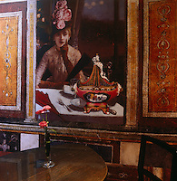 A faux frieze incorporating this portrait of a lady  dominates the wall of the breakfast room