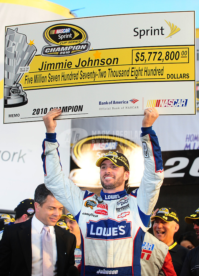 Nov. 21, 2010; Homestead, FL, USA; NASCAR Sprint Cup Series driver Jimmie Johnson (48) celebrates winning the NASCAR championship for the fifth consecutive year after the Ford 400 at Homestead-Miami Speedway. Mandatory Credit: Mark J. Rebilas-