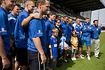 The first-team squad of Mansfield Town lining up for a team photograph with the Conference National trophy at Field Mill stadium during an open day held for the club's supporters. Mansfield Town achieved promotion back to England's Football League by winning the Conference National in season 2012-13. Field Mill was the oldest ground in the Football League, hosting football since 1861 although some reports date it back as far as 1850, with Mansfield Town having played there since 1919.