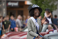 NWA Democrat-Gazette/J.T. WAMPLER EJ Ogbeide waves to the crowd Wednesday Sept. 30, 2015 during the Fayetteville High School homecoming parade. Ogbeide is a maid of honor in the homecoming court.