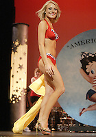 12 July, 2008:    Miss Tri-Cities Kristin Cox shows off her swim attire in the Physical Fitness in Swimsuit competition on stage during the 2008 Miss Washington pageant at the Pantages Theater in Tacoma , Washington.