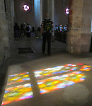 "VMI Vincentian Heritage Tour: Stained glass reflections on the floor of the Church of St Mary Magdalen in the hilltop village of Pérouges on Tuesday, June 28, 2016, site of the classic film ""Monsieur Vincent"". (DePaul University/Jamie Moncrief)"