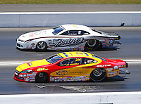 Jun 19, 2016; Bristol, TN, USA; NHRA pro stock driver Jeg Coughlin Jr (near) defeats Bo Butner during the Thunder Valley Nationals at Bristol Dragway. Mandatory Credit: Mark J. Rebilas-USA TODAY Sports