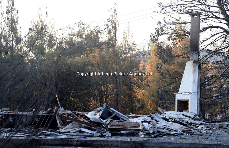Pictured: A damaged house in the area.<br />Re: A forest fire has been raging in the area of Kalamos, 20 miles north-east of Athens in Greece. There have been power cuts, country houses burned and children camps evacuated from the area.