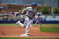 Midland RockHounds outfielder Jaycob Brugman (9) rounds third during a game against the Tulsa Drillers on June 3, 2015 at Oneok Field in Tulsa, Oklahoma.  Midland defeated Tulsa 5-3.  (Mike Janes/Four Seam Images)