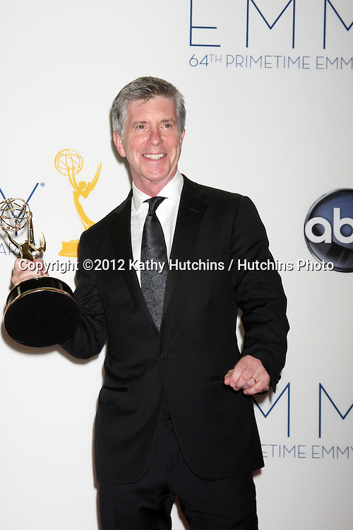 LOS ANGELES - SEP 23:  Tom Bergeron in the press room of the 2012 Emmy Awards at Nokia Theater on September 23, 2012 in Los Angeles, CA
